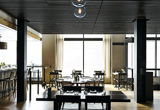 Shake and Spear dining room with 3 tables floor to ceiling windows